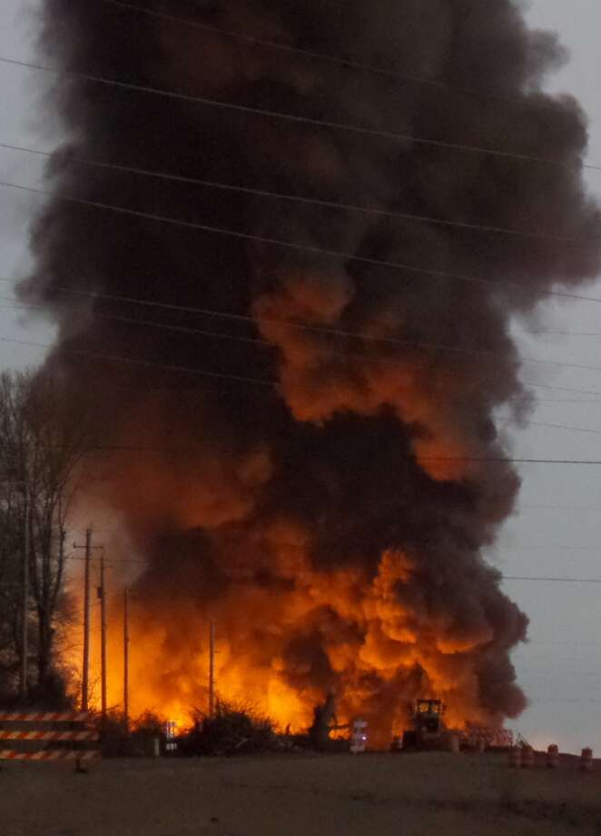 A fire at a biodiesel facility near New Albany, Miss., burns early Wednesday, Jan. 22, 2014.  The fire was so hot that firefighters could not get close enough to fight it, the Mississippi Highway Patrol said. Photo: Angie Barmer, ASSOCIATED PRESS