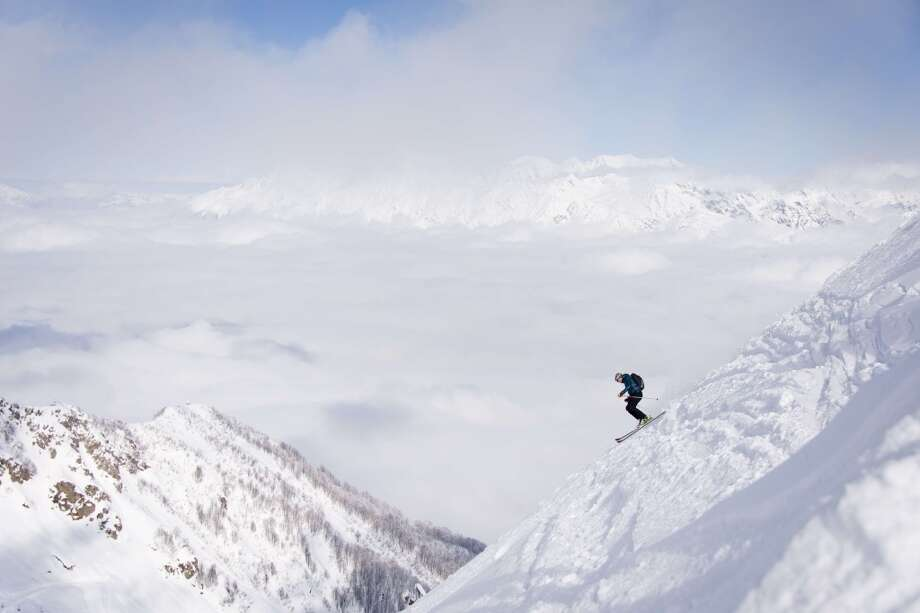 A file picture taken on February 13, 2013, in the Rosa Khutor Extreme Park, some 50 km from Russia's Black Sea resort of Sochi, shows a skier seting off from the peak of Mount Aigba. Photo: LEON NEAL, AFP/Getty Images