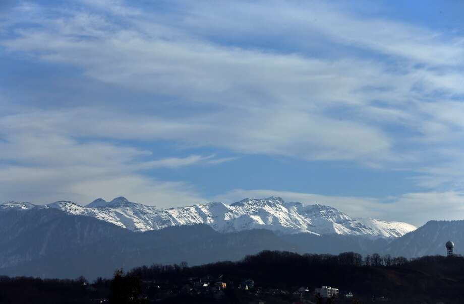 Snow covered mountains are seen from the Coastal Cluster on January 9, 2014 in Alder, Russia. The region will host the Sochi 2014 Winter Olympics which start on February 6th, 2014. Photo: Michael Heiman, Getty Images