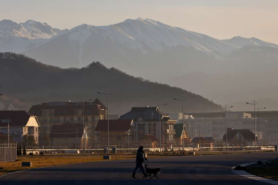 Military personnel with canine units patrol the Olympic Park in the Coastal Cluster on January 10, 2014 in Alder, Russia. The region will host the Sochi 2014 Winter Olympics which start on February 6th, 2014. Photo: Michael Heiman, Getty Images