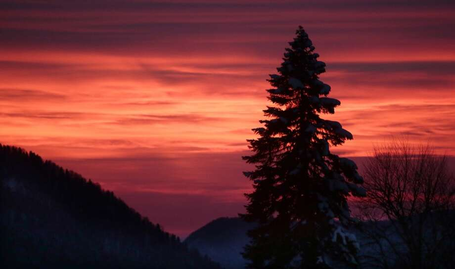 In this Feb. 3, 2013 file photo, the sun sets over mountains in Sochi, Russia. Photo: Mikhail Metzel, Associated Press
