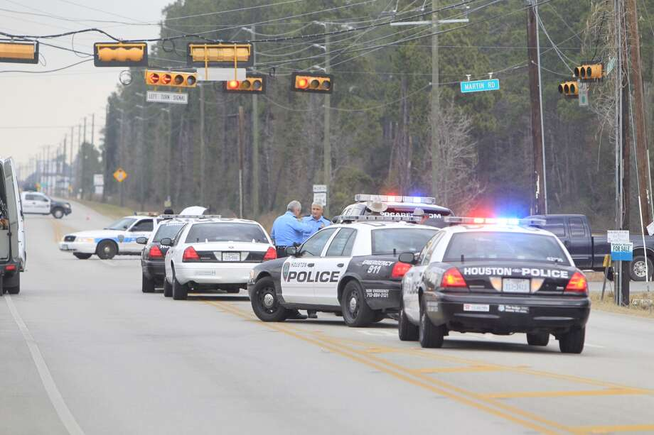 Police investigate a motorcycle wreck near Kingwood Thursday morning. Photo: Cody Duty, Houston Chronicle