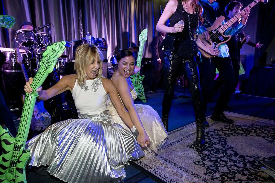 Sandy Mandel (left) dances with Vannessa DeMello after being invited to join the band onstage during the after party for San Francisco Ballet's Opening Night Gala in San Francisco, Calif., on Wednesday, January 22, 2014. Photo: Laura Morton, Special To The Chronicle