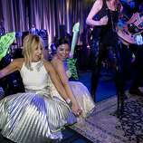 Sandy Mandel (left) dances with Vannessa DeMello after being invited to join the band onstage during the after party for San Francisco Ballet's Opening Night Gala in San Francisco, Calif., on Wednesday, January 22, 2014.