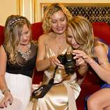 Julie Hall, Larissa Wilms and Lana Ricketts (left to right) look over photos they took during intermission at San Francisco Ballet's Opening Night Gala at War Memorial Opera House in San Francisco, Calif., on Wednesday, January 22, 2014.