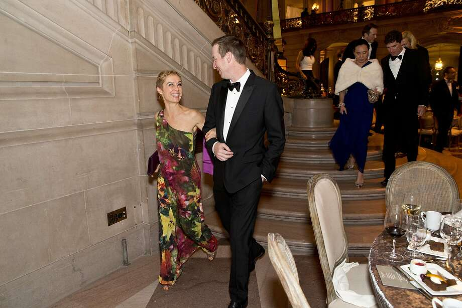 Larissa Roesch (left) walks with Philip Brady on their way to the ballet performance after enjoying dinner at City Hall. Roesch's floral dress is playful, but gala appropriate.  Photo: Laura Morton, Special To The Chronicle