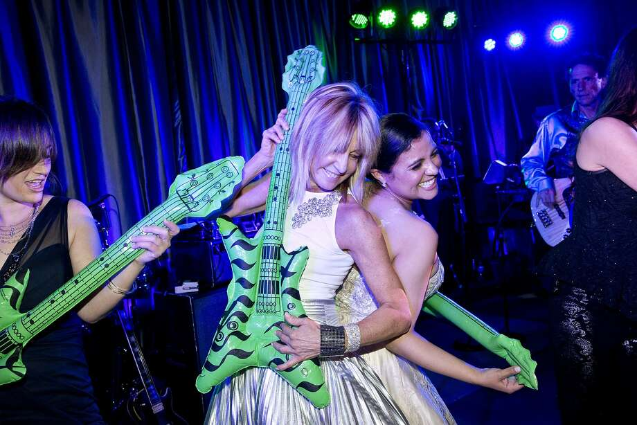 Michelle Keselman (left), Sandy Mandel and Vannessa DeMello groove onstage at the S.F. Ballet's opening night gala. Photo: Laura Morton, Special To The Chronicle