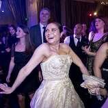 Vannessa DeMello (center) enjoys the dance floor while attending the after party for San Francisco Ballet's Opening Night Gala at City Hall in San Francisco, Calif., on Wednesday, January 22, 2014.