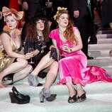 Melissa Castaneda, Hailey Gaiser and Elizabeth Castaneda (left to right) relax on the stairs of City Hall during the after party for San Francisco Ballet's Opening Night Gala in San Francisco, Calif., on Wednesday, January 22, 2014.