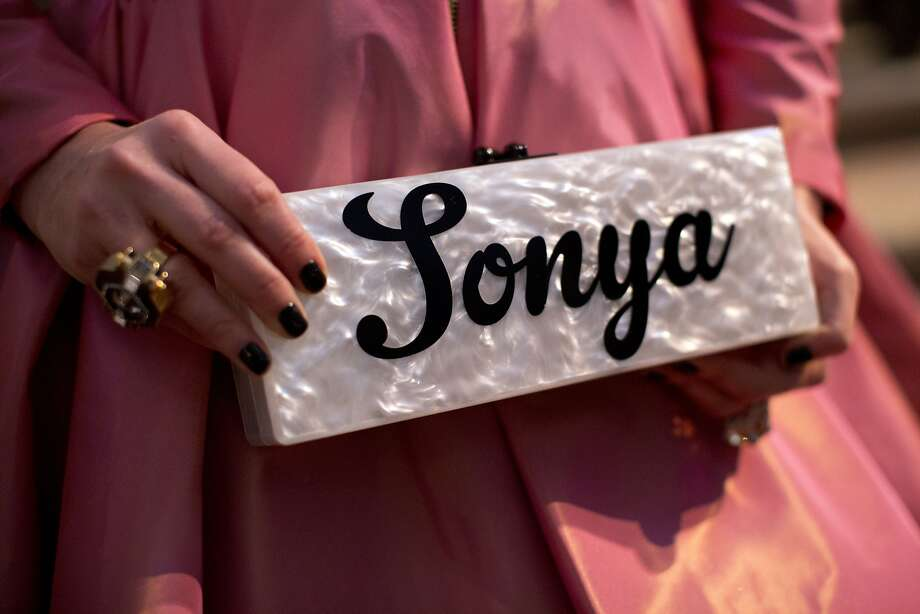 ...her Edie Parker personalized clutch. Photo: Laura Morton, Special To The Chronicle