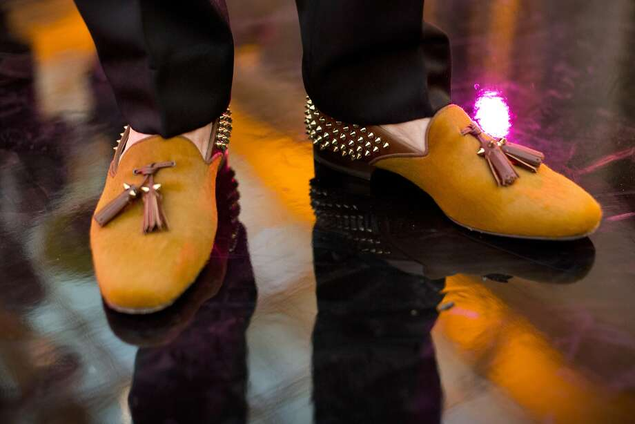 Although many of the Gala's male attendees stuck with black, Brad Somberg dressed things up with unique Christian Louboutin loafers. Photo: Laura Morton, Special To The Chronicle