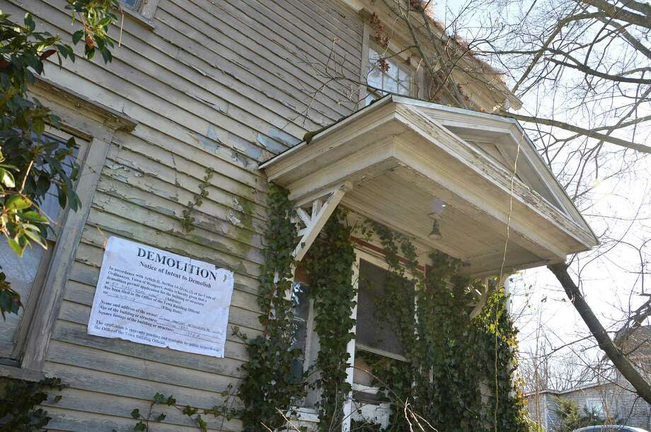 "One of the four dilapidated buildings on Post Road West has been posted for ""Demolition"" by the owner. Photo: Jarret Liotta / Westport News contributed"