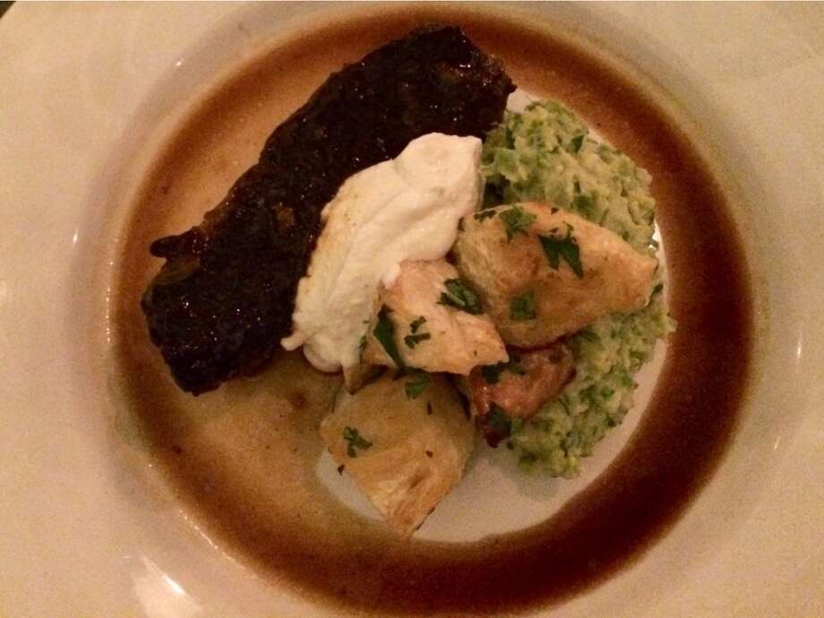 Red-wine braised short ribs with creamed Brussels sprouts, chunks of roasted celery root and horseradish ($27)