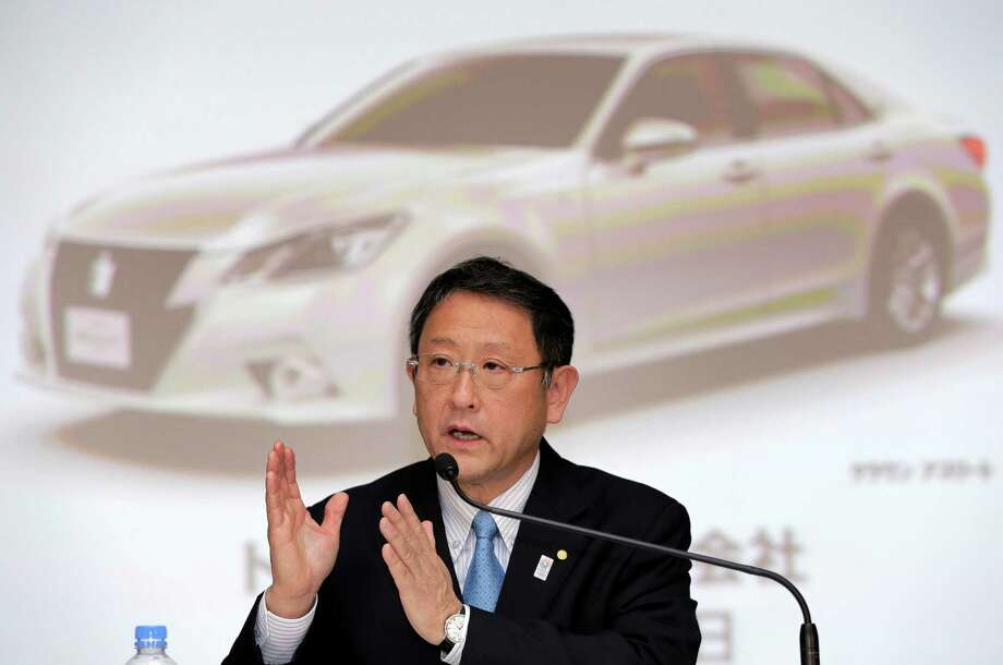 FILE - In this May 8, 2013 file photo, Toyota Motor Corp. President Akio Toyoda speaks during a news conference at the automaker's headquarters in Tokyo. Toyota remained the top-selling automaker for a second year in a row, beating U.S. rival General Motors by some 270,000 vehicles in 2013, and set an ambitious target to sell more than 10 million vehicles in 2014. That would mark a milestone as no automaker has ever topped annual worldwide sales of 10 million. Photo: Itsuo Inouye, AP / AP