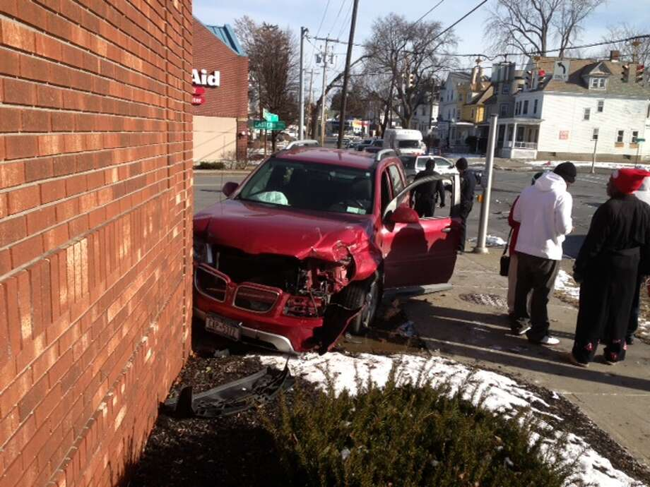 An SUV crashed into the CVS pharmacy at the corner of Eastern Avenue and McClellan Street in Schenectady. (Paul Nelson / Times Union)