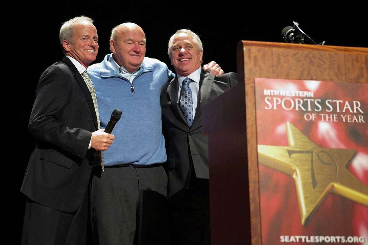 Howard Wright, left, and cyclist and Tour de France winner Greg LeMond, right, honor filmmaker Warren Miller, center, with the Keith Jackson Award during the 79th annual Sports Star of the Year awards.