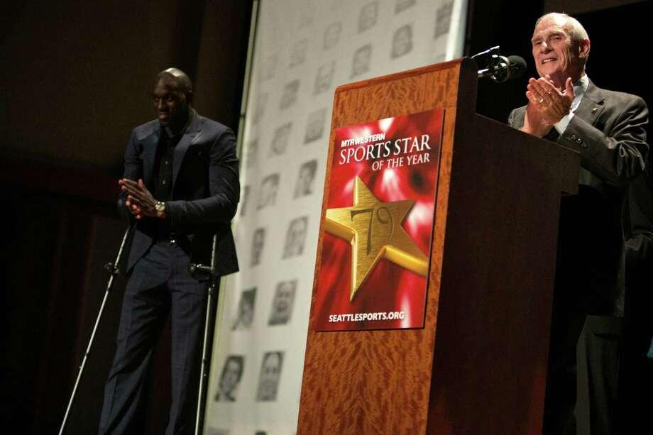 Paul Allen Sports Citizen Award honoree Ron Crockett applauds after he was introduced by Memphis Grizzlies player Quincy Pondexter who he helped through school. Photo: JOSHUA TRUJILLO, SEATTLEPI.COM / SEATTLEPI.COM