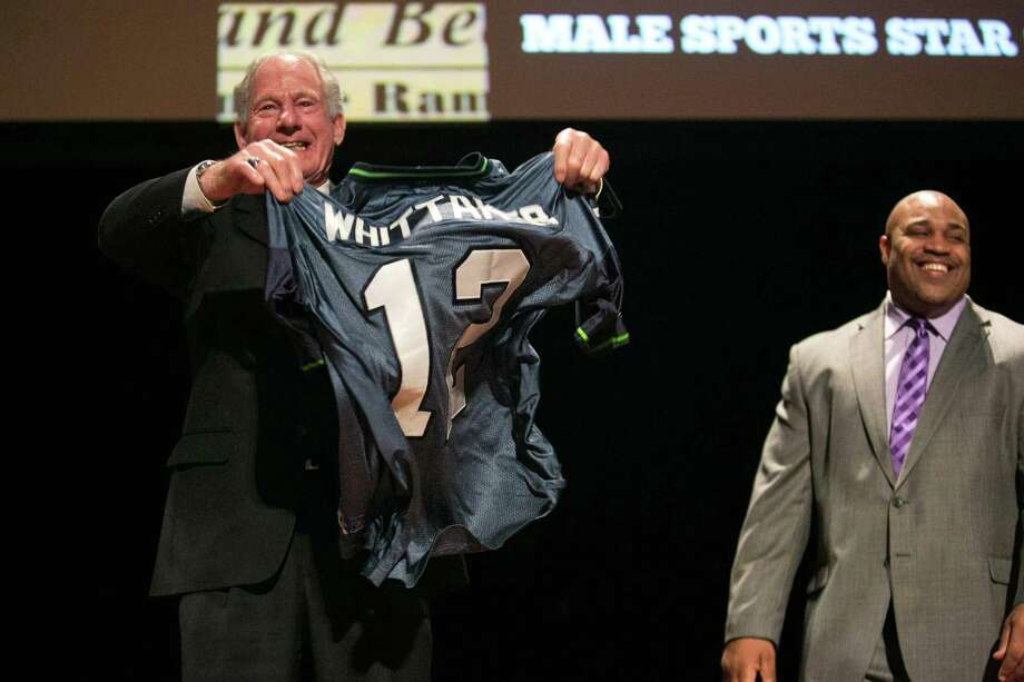 Mountaineering legend Jim Whittaker holds up his 12th Man jersey during the 79th annual Sports Star of the Year awards after announcing Russell Wilson as the winner of the Male Sports Star of the Year. Photo: JOSHUA TRUJILLO, SEATTLEPI.COM / SEATTLEPI.COM