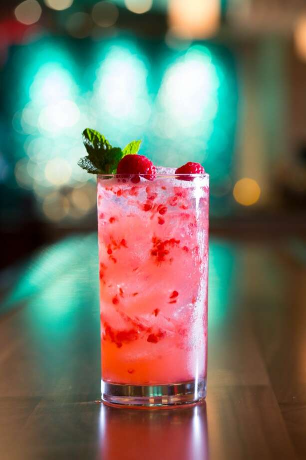 "The Rapberry Rickey (known for being the only mixed drink mentioned in ""The Great Gatsby"") is made with gin, club soda, fresh lime and raspberries. (Photo: Eddie V's)"