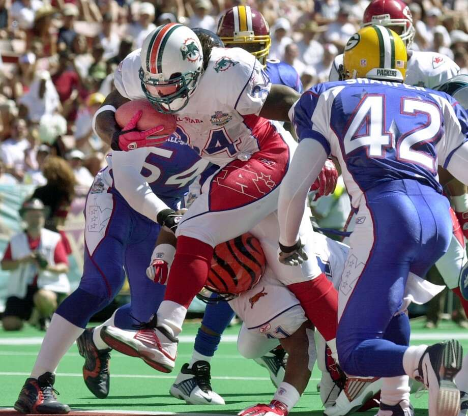 2003 — Ricky Williams, RB, Miami Dolphins  Score: AFC 45, NFC 20 Photo: Reed Saxon, Associated Press