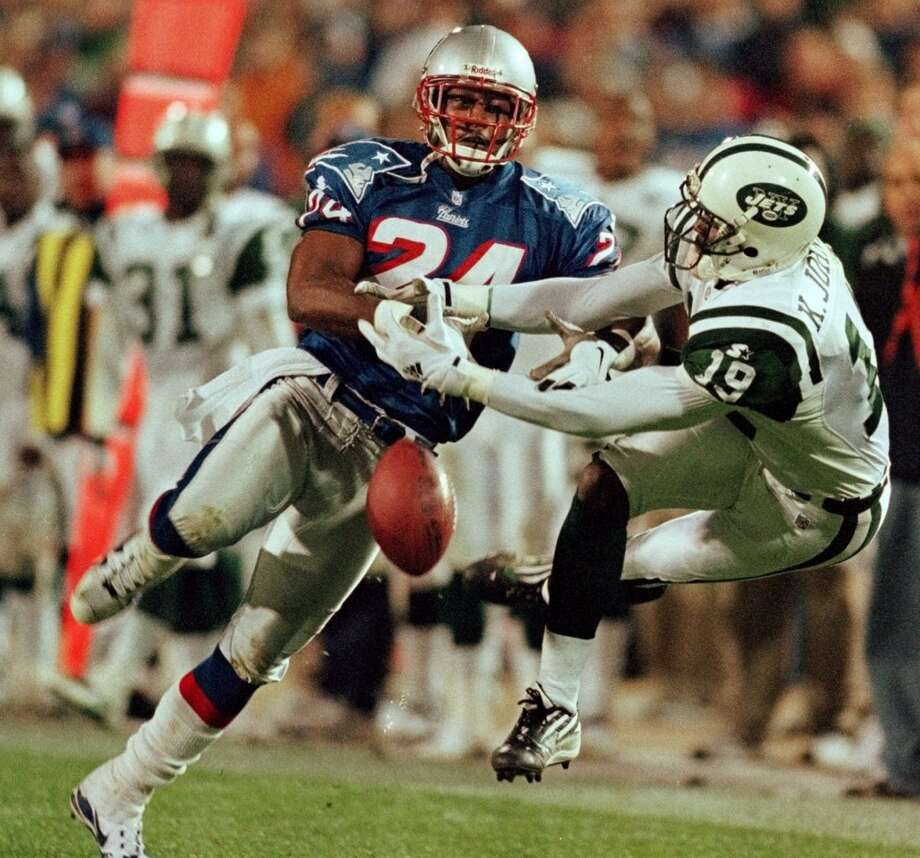 1999 — Keyshawn Johnson, WR, New York Jets, and Ty Law, CB, New England Patriots  Score: AFC 23, NFC 10 Photo: Winslow Townson, Associated Press