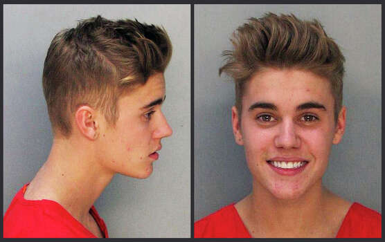 Justin Bieber and singer Khalil were arrested Jan. 23, 2014 for allegedly drag-racing on a Miami Beach Street. Police say Bieber has been charged with resisting arrest without violence in addition to drag racing and DUI. Police also say the singer told authorities he had consumed alcohol, smoked marijuana and taken prescription drugs. Photo: Uncredited, Miami Dade County Jail / THE ASSOCIATED PRESS2014