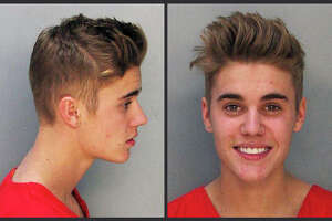 These police booking mugs made available by the Miami Dade County Corrections Department show pop star Justin Bieber, Thursday, Jan. 23, 2014. Bieber and singer Khalil were arrested early Thursday for allegedly drag-racing on a Miami Beach Street. Police say Bieber has been charged with resisting arrest without violence in addition to drag racing and DUI. Police also say the singer told authorities he had consumed alcohol, smoked marijuana and taken prescription drugs.