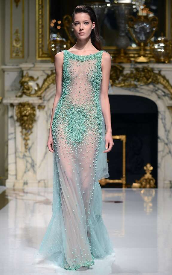 "A model displays a creation by Lebanese designer Charlotte Licha for her 2014 Haute Couture collection ""Points"" show held at Shangri-La hotel in Paris, on January 22, 2014.  Charlotte Licha is the first Lebanese woman to hold a show in Paris, after years of Lebanese famous male designers like Elie Saab, Zuhair Murad, Geores Hobeika among others. Licha's first collection 'Point' is dedicated to a woman who 'dares to be different, and represents the feeling of life', as she says.  Photo: Ammar Abd Rabbo, AFP/Getty Images"