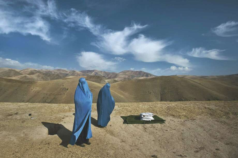"""""""On The Wire: Veiled Rebellion,"""" an exhibition that opens at Westport Arts Center on Friday, Jan. 24, 2014, will showcase 34 color photographs by Lynsey Addario, such as the one pictured, on the plight of women in Taliban-controlled Afghanistan. For more information, visit www.westportartscenter.org. Contributed photo/Lynsey Addario Photo: Contributed Photo / Stamford Advocate Contributed"""