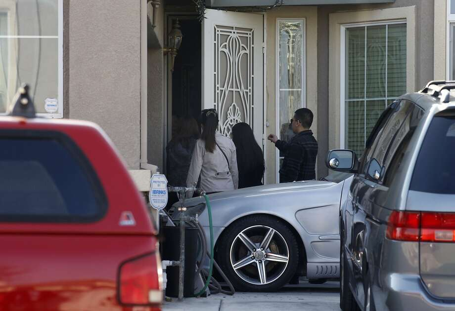 Visitors arrive to the home in Oakley, Calif., on Thursday Jan. 23, 2014, where an 11-year-old Oakley boy intentionally shot and killed himself, police say. Photo: Michael Macor, The Chronicle