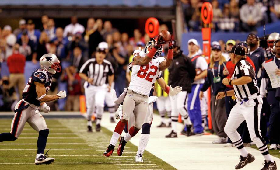 10. Super Bowl XLVINew York Giants 21, New England 17. Mario Manningham's clutch sideline catch on the Giants' final drive gave Eli Manning and New York a chance to take the lead with less than a minute left. Tom Brady's Hail Mary attempt dropped just out of reach of a diving Rob Gronkowski, dropping Brady's Super Bowl record to 3-2. Photo: Rob Carr, Rob Carr/Getty Images / 2012 Getty Images