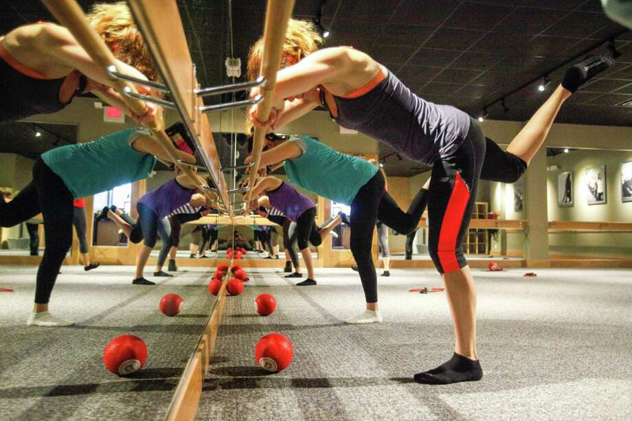 Pure Barre students focus on form while using the barre for support. Instructor Diana Hare-Ganchev says the workout uses body-weight resistance in a combination of stretching, lengthening and pulsing exercises. Photo: Eric Kayne / Eric Kayne