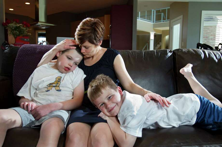 Colleen O'Brien, wife of new Texans coach Bill O'Brien, spends time with their sons Jack, 11, left, and Michael, 8. Jack suffers from lissencephaly, a genetic condition that results in developmental damage. Photo: JOE HERMITT, STAFF PHOTOGRAPHER / THE PATRIOT-NEWS