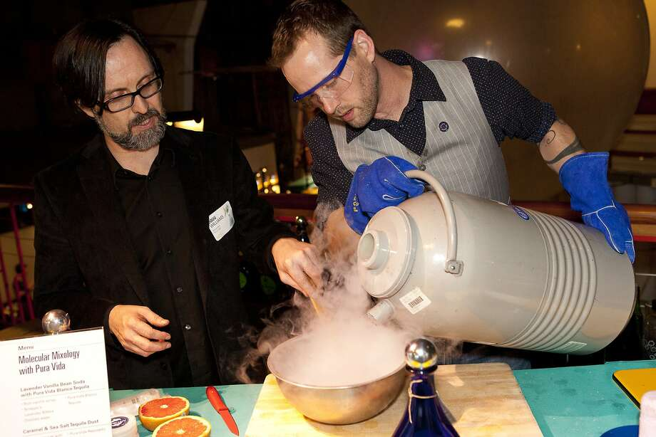 Mixologists Doug Williams (left) and Tom Mich use liquid nitrogen during a molecular mixology demonstration when the Exploratorium held its Science of Cocktails event in 2012. Photo: Gayle Laird, Courtesy Of The Exploratorium