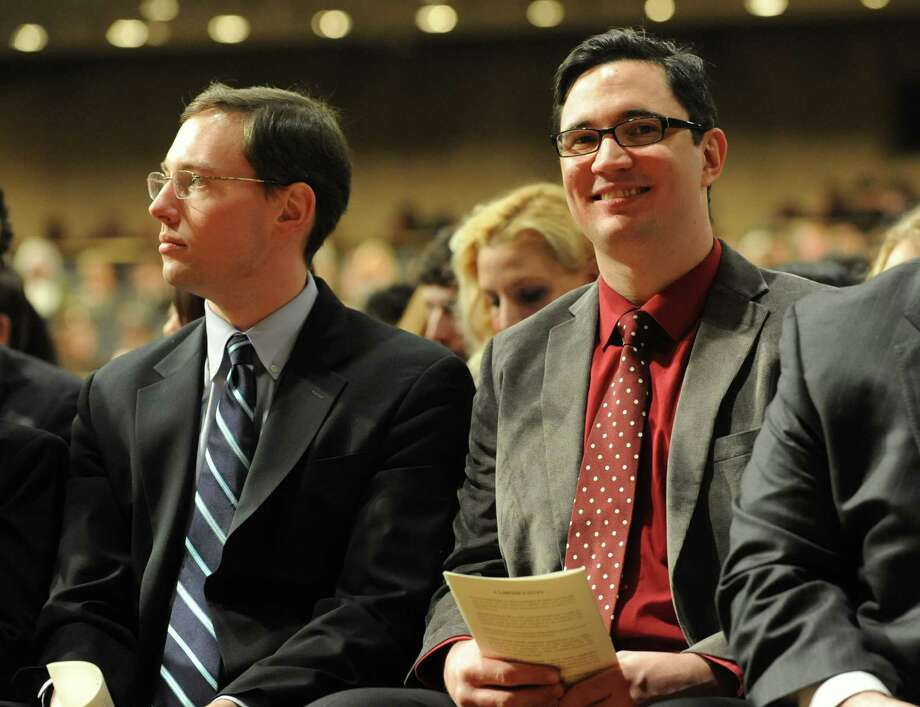 Joseph Fornadel, left, sits with Ivan Pavlenko during a ceremony where about 750 people were sworn in as newly admitted members of the New York State Bar by the Court at the Empire State Convention Center on Thursday, Jan. 23, 2014 in Albany, N.Y. (Lori Van Buren / Times Union) Photo: Lori Van Buren / 00025293A