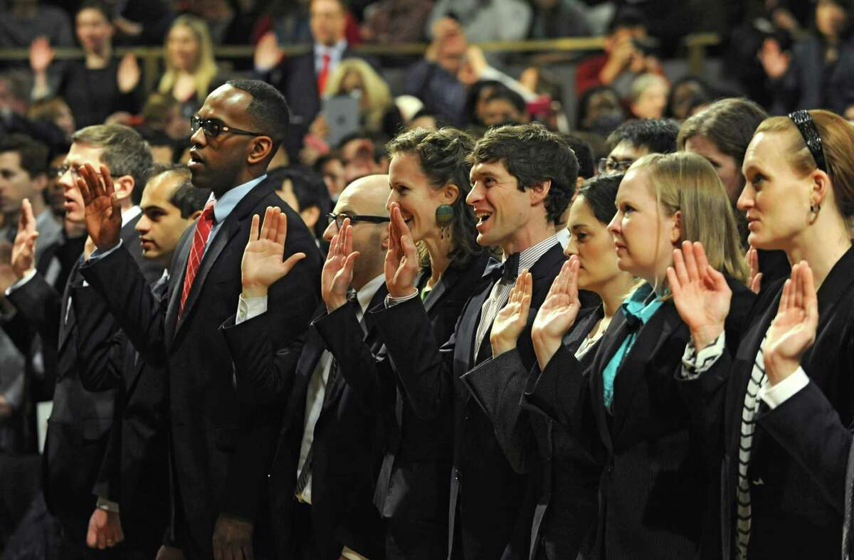 About 750 people are sworn in as newly admitted members of the New York State Bar by the Court at a ceremony at the Empire State Convention Center on Thursday, Jan. 23, 2014 in Albany, N.Y. (Lori Van Buren / Times Union)