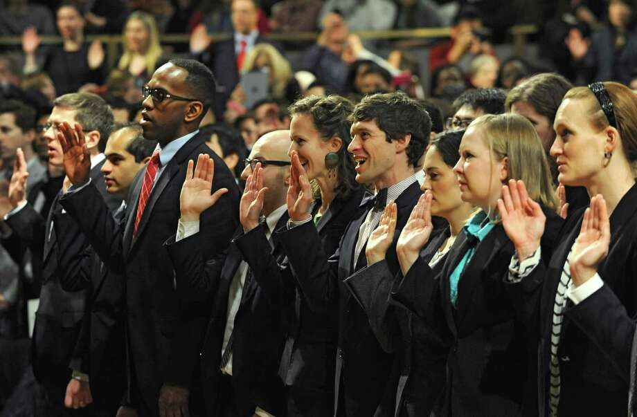 About 750 people are sworn in as newly admitted members of the New York State Bar by the Court at a ceremony at the Empire State Convention Center on Thursday, Jan. 23, 2014 in Albany, N.Y. (Lori Van Buren / Times Union) Photo: Lori Van Buren / 00025293A