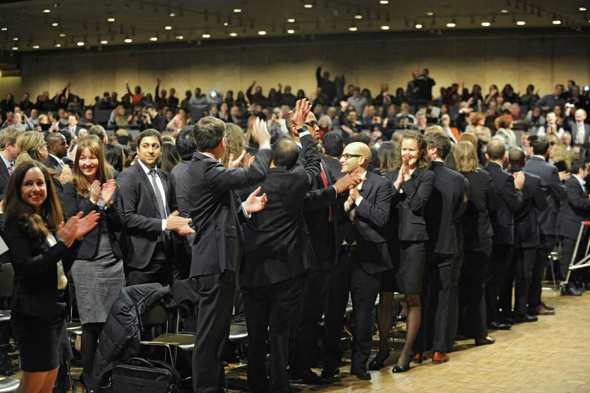 Newly admitted members of the New York State Bar turn around to thank their families for all their support during a ceremony at the Empire State Convention Center on Thursday, Jan. 23, 2014 in Albany, N.Y. (Lori Van Buren / Times Union)