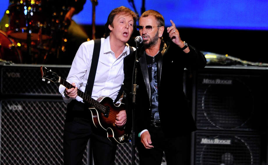 FILE - This April 4, 2009 file photo shows Paul McCartney, left, and Ringo Starr performing at the Change Begins Within Concert in New York. The Recording Academy announced Tuesday, Jan 14, 2014, that both McCartney and Starr will perform at the Jan. 26 Grammy awards show. The Beatles will be honored at the Academy's Special Merits Awards a day before, and a day after the big show, the iconic group will be the center of a performance special featuring Eurythmics and other acts playing Beatles hits. (AP Photo/Stephen Chernin, File) ORG XMIT: NYET201 Photo: Stephen Chernin / FR76594 AP