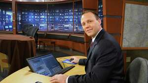 WNYT meteorologist Paul Caiano in their studios Friday Jan. 17, 2014, in Albany, NY.  (John Carl D'Annibale / Times Union)