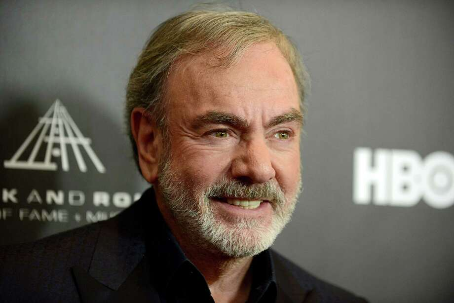 "This Thirsday, April 18, 2013 photo shows Neil Diamond at the Rock and Roll Hall of Fame Induction Ceremony at the Nokia Theatre  in Los Angeles. Diamond said he's happy his ""Sweet Caroline,"" a staple of Boston Red Sox games, can provide comfort after the Boston Marathon bombing. ""There is a lot of comfort that music can offer,"" Diamond told The Associated Press. ""In this particular situation, I'd much rather it not have happened than for 'Sweet Caroline' to become part of it. But it's obviously offering comfort to people and I feel good about that.""  (Photo by Jordan Strauss/Invision) Photo: Jordan Strauss / Invision"