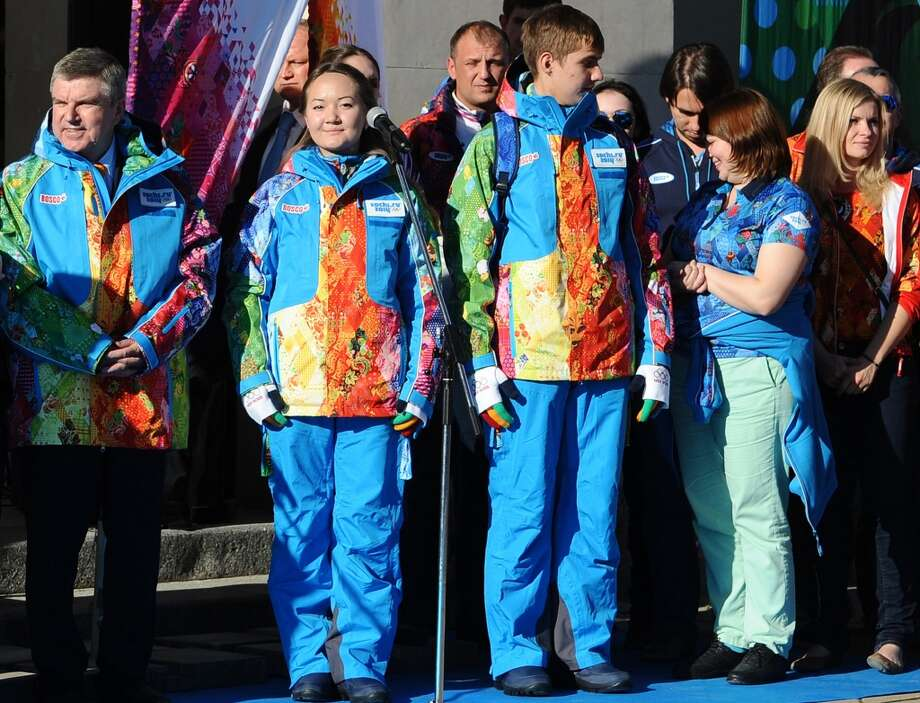 Oh, the poor Winter Olympics volunteers. They'll be stuck wearing this awful jacket throughout the games. At least they'll be easy to spot? (MIKHAIL MORDASOV/AFP/Getty Images) Photo: AFP, AFP/Getty Images