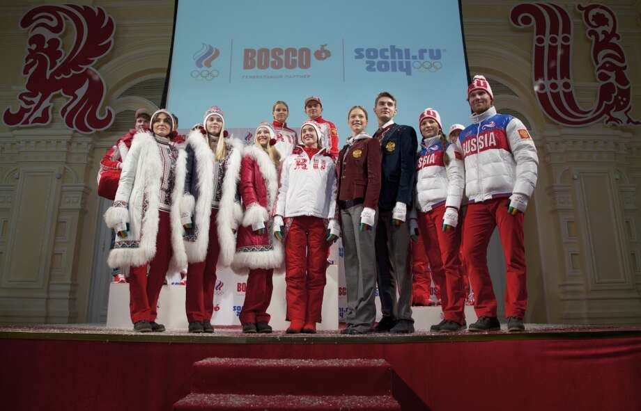 Celebrities and athletes present a set of uniforms for the Russian national Olympic team. The third woman from the left is sporting a very Santa Claus-inspired look. (AP Photo/Ivan Sekretarev) Photo: Ivan Sekretarev, Associated Press