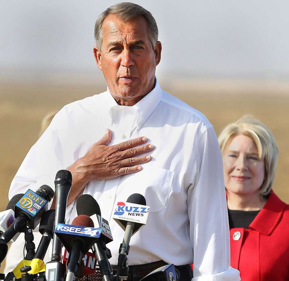 House Speaker John Boehner talks about the drought in the Central Valley, Wednesday, Jan. 22, 2014, during a news conference on farmer Larry Starrh's land, northwest of Bakersfield, Calif. State Sen. Jean Fuller is behind him. Boehner visited a dusty California field, joining Central Valley Republicans to announce an emergency drought-relief bill to help farmers through what is certain to be a devastating year. If passed, the bill that's already stirring controversy would temporarily halt restoration of the San Joaquin River designed to bring back the historic salmon flow, among other measures. Farmers want that water diverted to their crops. (AP photo/The Bakersfield Californian, Casey Christie) MAGS OUT  ONLINES OUT  TV OUT  NO SALES Photo: Casey Christie, Associated Press