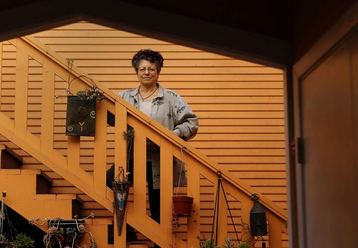 Sue Kearney, on Tuesday Jan. 21, 2014, at her Oakland, Calif. home. Kearney has an undiagnosed digestive disorder that hasn't responded to treatments. After signing up for Covered California she was really excited to have health insurance because she is self employed, but now she can't find a doctor to treat her. She has a list of tests to be performed but is having trouble finding a medical lab.