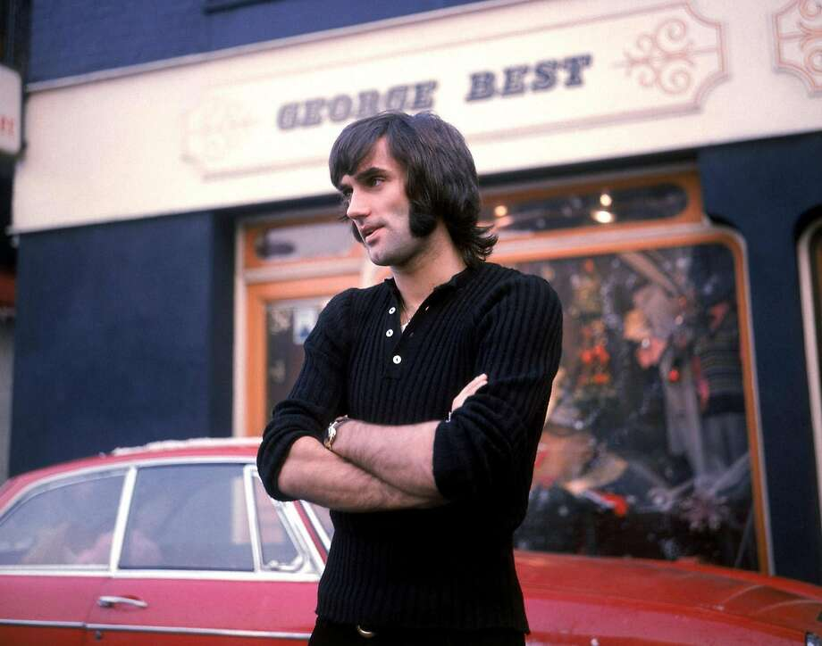George Best stands outside his store in 1970, years before he played for the Quakes in the 1980s. Photo: Pa, AP