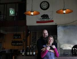 Ryan and Megan Glaab stand in their winery where they create their own range of Italian inspired wines under their Ryme Cellars label, Monday January 20, 2014, in Forestville,  Calif.