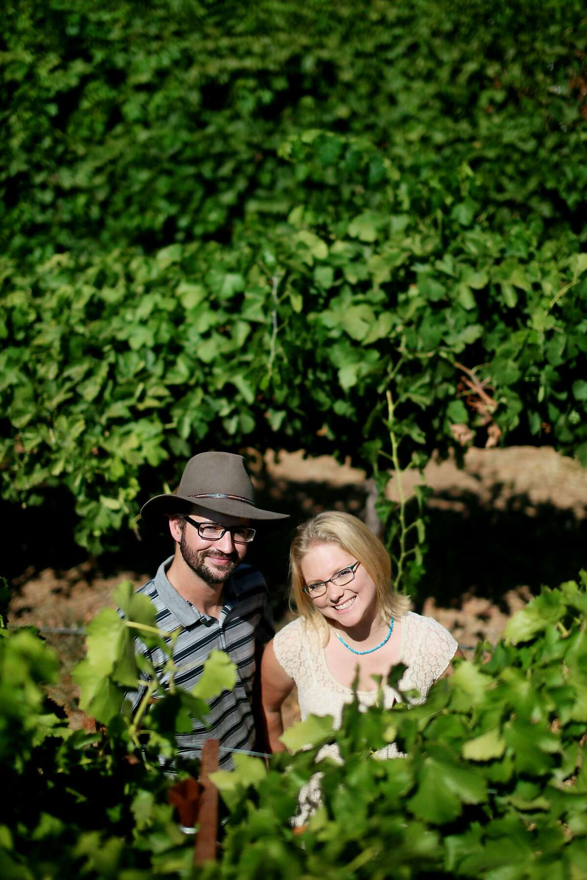 Alysha Stehly and Chris Broomwell stand at Highland Hills Vinyard in Ramona, CA on Friday, August 16, 2013. Chris and Alysha (husband and wife) both come from old SD farming families, and now make wine together, with some combination of their own label and work done for the vineyards that Alysha's father installs.(Photo by Sandy Huffaker for The SF Chronicle)
