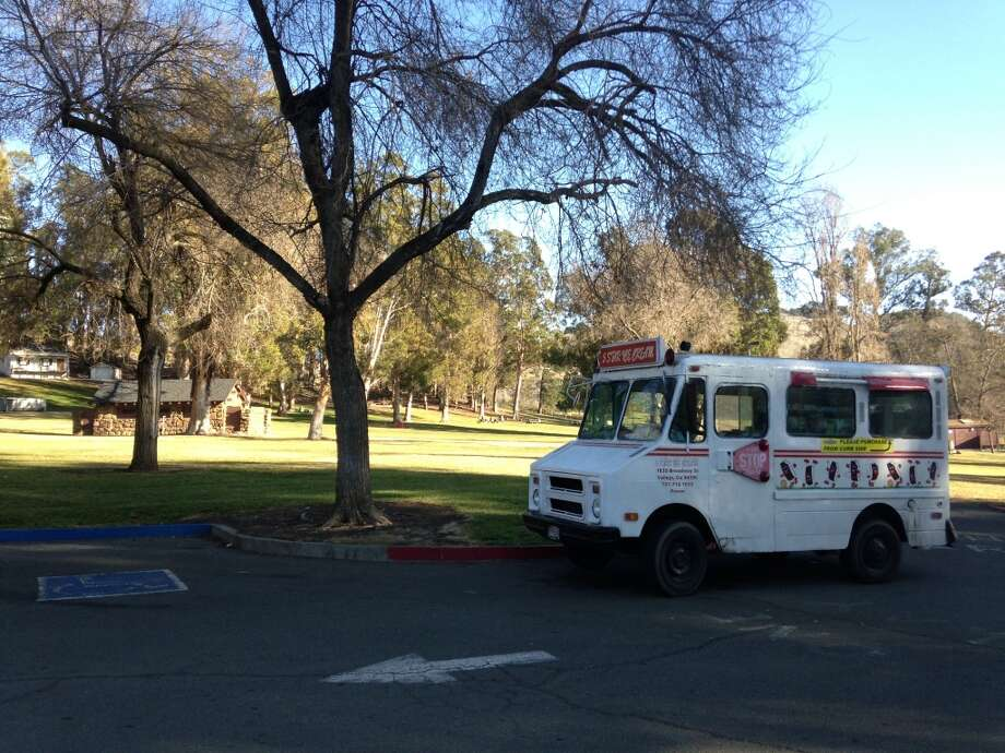 The parking lot at Blue Rock Springs Park, where this ice cream truck serves to scare all who pass. Photo: Beth Spotswood