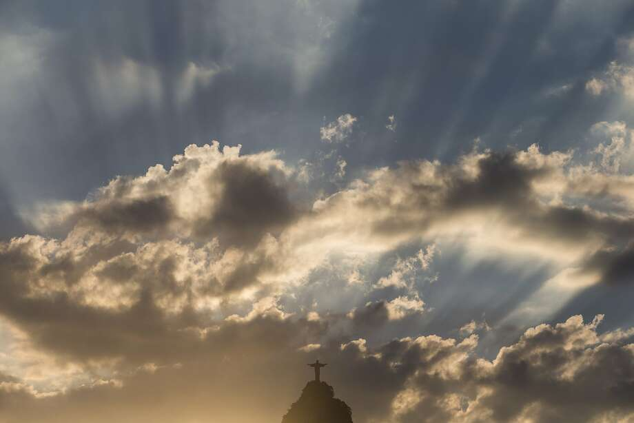 A dramatic evening sky frames the Christ the Redeemer statue  in Rio de Janeiro. Photo: Felipe Dana, Associated Press